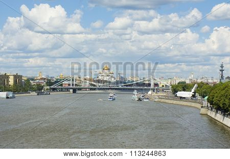 Orthodox cathedral of Jesus Christ Saviour and Krymskiy bridge on Moscow-river in Moscow Russia.
