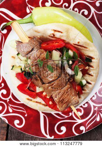 Souvlaki or kebab, meat skewer served with pita bread