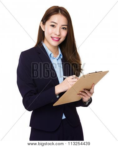 Young Businesswoman take note on clipboard