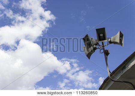 loud-hailer a loudspeaker against the sky