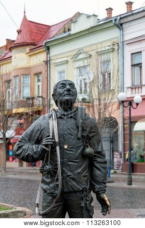 Mukachevo Ukraine - April 6 2015: Monument of Happy Chimney Sweeper and his cat. The monument with real chimney sweeper Bertalon Tovt by Ukrainian sculptor Ivan Brovdi