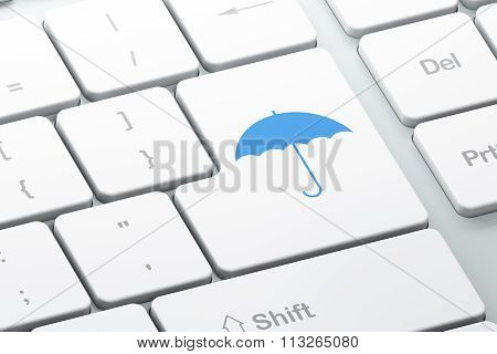 Protection concept: Umbrella on computer keyboard background