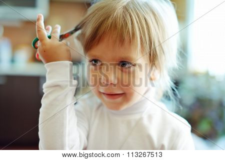 Cute Little Girl With Scissors