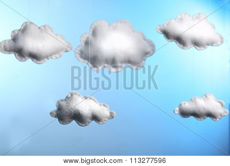 Fleece clouds on blue background