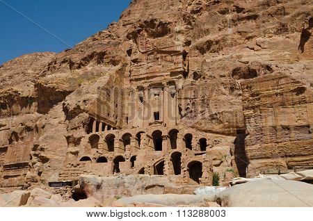 Walking Between Construction Of The Abandoned City Of Petra In Jordan