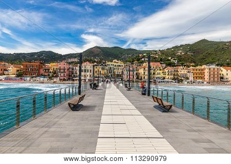 View Of Mole Leading To The Town Of Alassio Full Of Colorful Buildings During Summer Day-AlassioItalyEurope poster