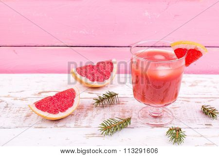 Grapefruit Juice In A Glass On A Table