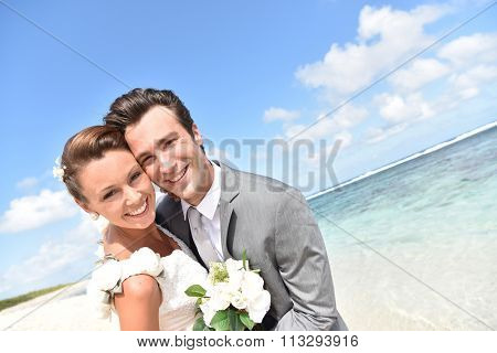Portrait of happy just-married couple at the beach