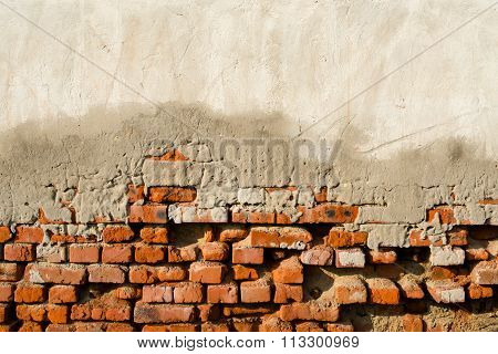 Partly Plastered Old Brick Wall