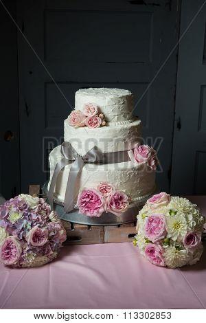 Wedding Cake Sitting On Wooden Trays
