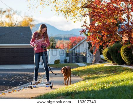 Teen girl riding hoverboard
