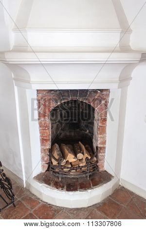 Old fireplace with firewood