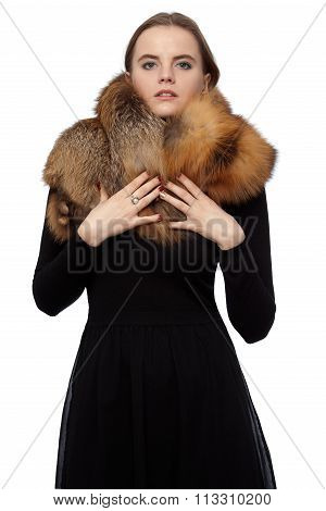 L Woman In Black Dress With A Fur Collar