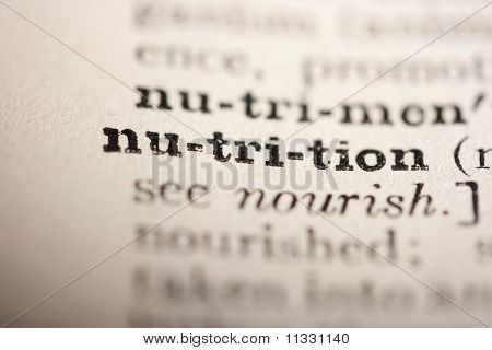 Word nutrition from the old dictionary a close up. poster