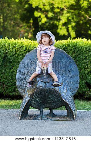 Cute Little Girl On A Turkey Statue
