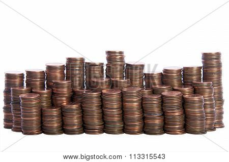 stacks of old dirty pennies. bronze and copper pennies isolated on a white background