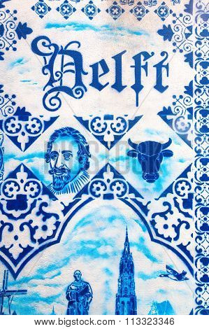 DELFT, NETHERLANDS - SEPTEMBER 04, 2015: painted Delft pottery seen at a wall in the old town of Delft. Delft pottery is blue and white tin-glazed pottery made in and around Delft from 16th century