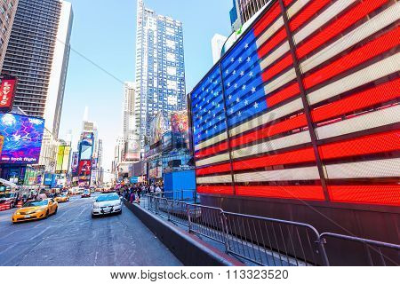 neon US flag at Times Square, Manhattan, NYC