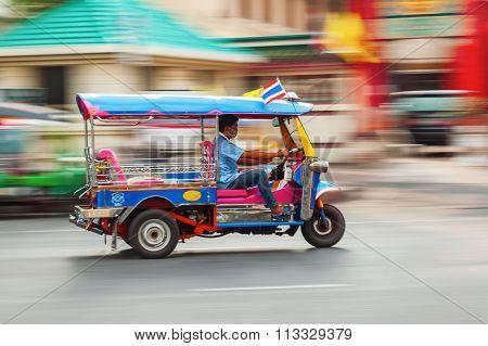 traditional tuktuk in Bangkok, Thailand, in motion blur