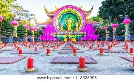 Beautiful candles in courtyard honor Buddha Amitabha
