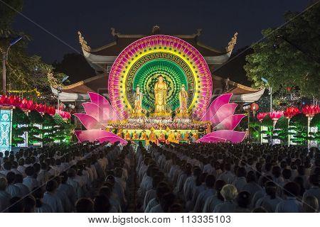 Buddhists toward stage during ceremony night Buddha Amitabha