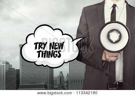 Try new things text on speech bubble with businessman holding paper plane in hand