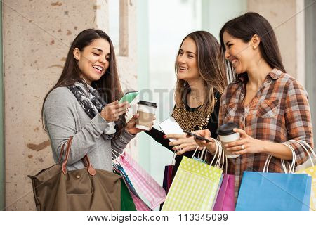 Women Shopping And Using Their Smartphones