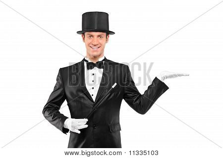 Magician Wearing Top Hat With Raised Left Hand