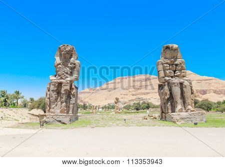 Egypt. Luxor. The Colossi of Memnon - two massive stone statues of Pharaoh Amenhotep III
