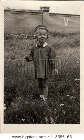 Vintage photo of the small girl. Photo was taken in early forties