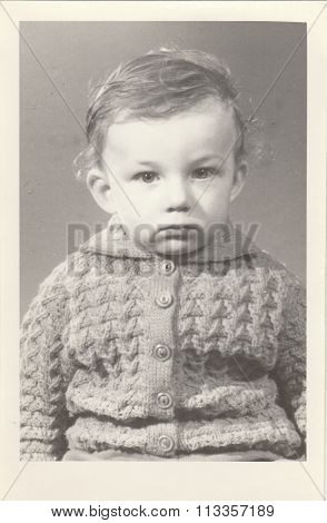 A small boy retro photo. Portrait photo was taken in photo studio. Early seventies.