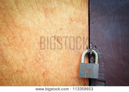 Textured Wooden Door with Padlock