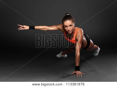 Young Woman Doing Push-Ups workout fitness posture body building exercise exercising on studio poster