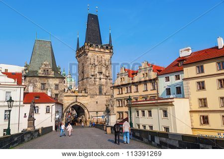 PRAGUE - SEPTEMBER 04: Bridge Tower of Charles Bridge with unidentified people on September 04, 2014 in Prague. Its a famous historic bridge crossing Vltava river, built 1357 - 15th century