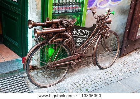 PRAGUE, CZECH REPUBLIC - SEPTEMBER 04, 2015: bicycle rebuilt in a steampunk way, staying in front of the bar Absintherie in Prague. It is a unique bar that presents about 60 kinds of absinthe