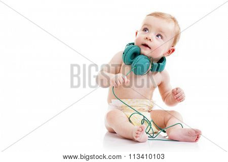 Baby with headphones looking up, isolated on white background