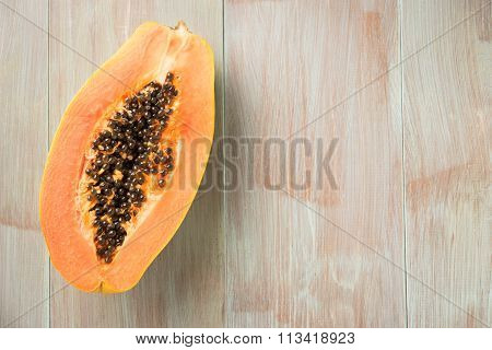 Sliced Fresh Papaya On Wooden Background. Top View With Copy Space