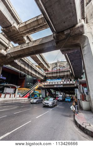 BANGKOK, THAILAND - DECEMBER 11,2014: street scene under the skytrain in Silom district with unidentified people. Bangkok is one of the most important economic and transport centres in South-East Asia