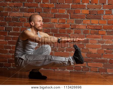 Athlete Man Performing Squat On One Leg