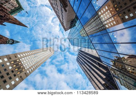 NEW YORK CITY - OCTOBER 07, 2015: skyscrapers in Manhattan, NYC, seen in low angle view. The metropolitan area NYC is one of the most important economy areas and commercial center of the world