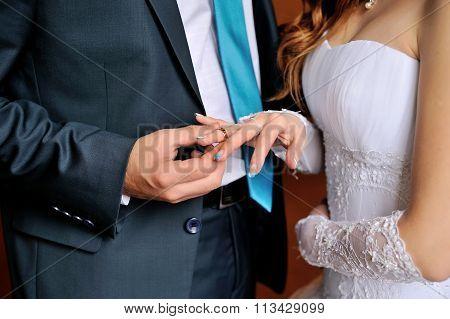 Groom Dresses Bride Wedding Ring On The Finger