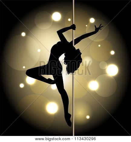 Silhouette of a sexy female pole dancing