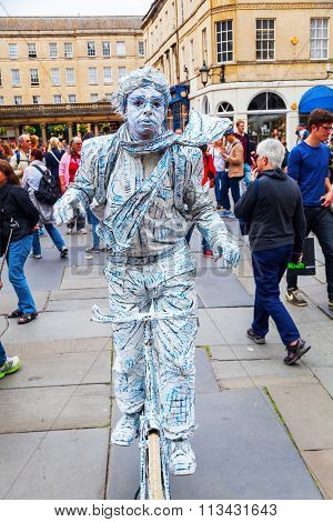 BATH, ENGLAND - JUNE 28, 2015: street artist in Bath is known for the curative Roman-built baths that still exist there and is is a UNESCO world heritage site since 1987