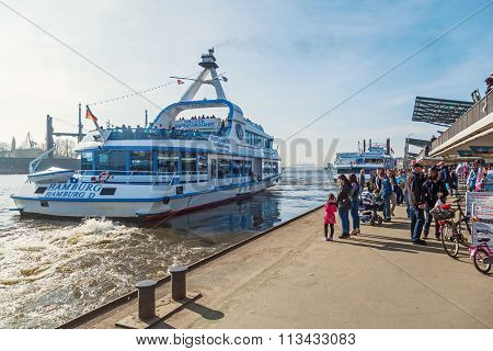 HAMBURG, GERMANY - MARCH 09: St Pauli Piers with unidentified people on March 09, 2014 in Hamburg. The Piers are the largest landing place in the Port of Hamburg and a major tourist attraction