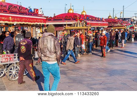 ISTANBUL, TURKEY - APRIL 10, 2015: fish restaurants with unique boats along the border of the Golden Horn with unidentified people. Istanbul is the largest city in Turkey and famous travel destination
