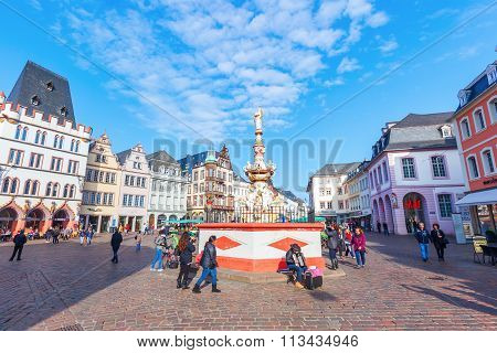 TRIER, GERMANY - NOVEMBER 05, 2015: main market square in Trier with unidentified people. It lies in the historical city center with a lot of old buildings from renaissance, baroque and classicism