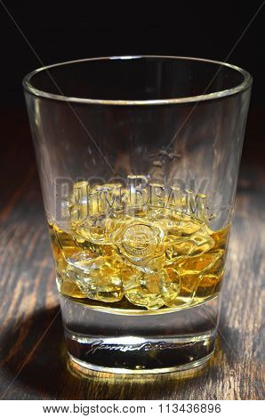 Jim Beam bourbon whiskey on wooden table