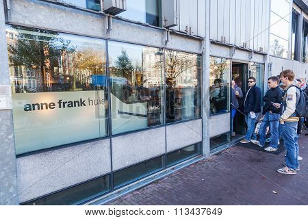 AMSTERDAM, NETHERLANDS - NOVEMBER 13: Anne Frank House with unidentified people on November 13, 2014 in Amsterdam. Its a biographical museum dedicated to Jewish wartime diarist Anne Frank