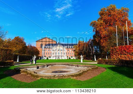 TRIER, GERMANY - NOVEMBER 05, 2015: electoral palace with unidentified people. It is a renaissance and rococo building from 17th century, where formerly the archbishop-electorals of Trier resided