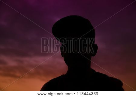 Silouette Of Boy With Cap In Front Of Wonderful Sunset